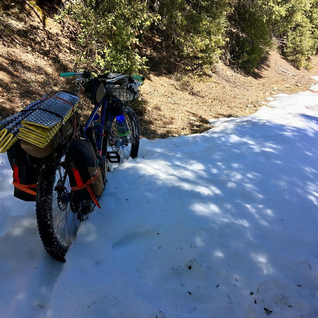 """Don't go over the mountains, there's still snow up there…"" one voice whines, ""Go around and have a relaxing ride"" While another voice grunts, ""Fuck it, there ain't that much…"" As usual we reached a compromise"